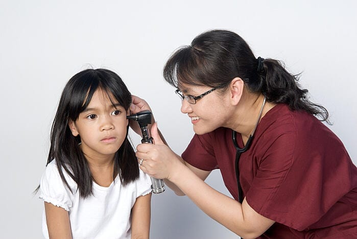 Woman Examining Childs Ear