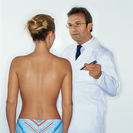Doctor Explaining Breast Augmentation