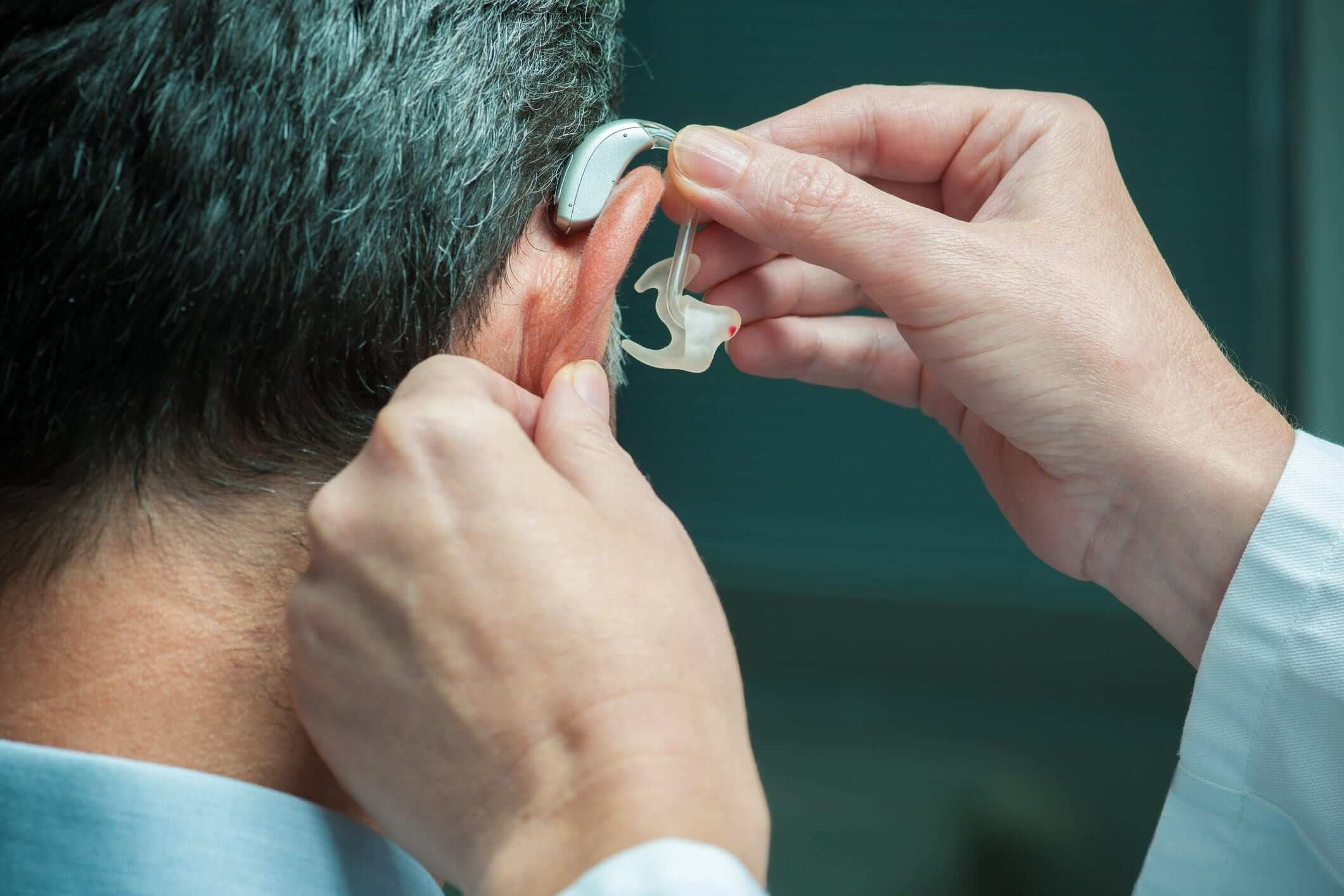Man With Hearing Aids Being Placed
