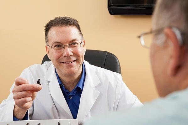 Doctor Explaining Hearing Aids