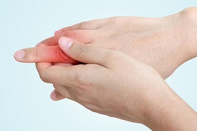 Person Holding Finger In Pain