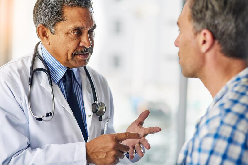 Dr. Talking To Male Patient