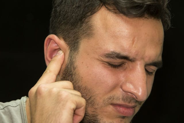 Man Touching His Ear