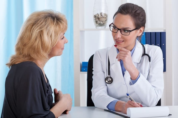 Woman Asking Surgeon Questions