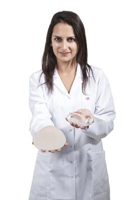 Doctor Showing Implants