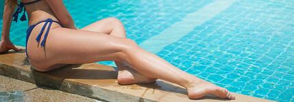 Woman Laying By Pool
