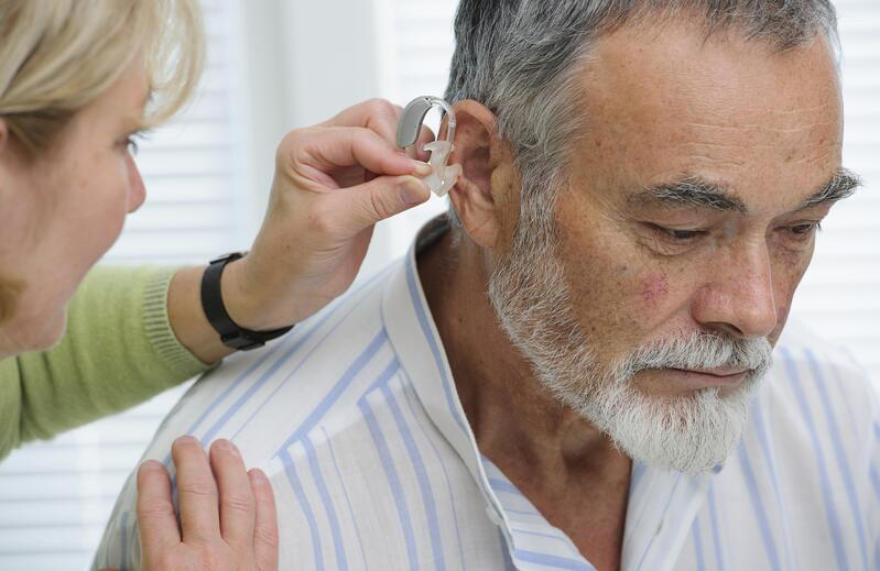 Doctor Examining Ears