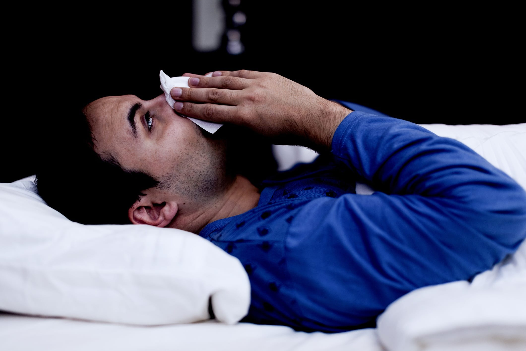 Man with allergies At Night