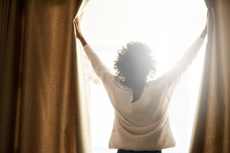Woman Opening Window Curtains