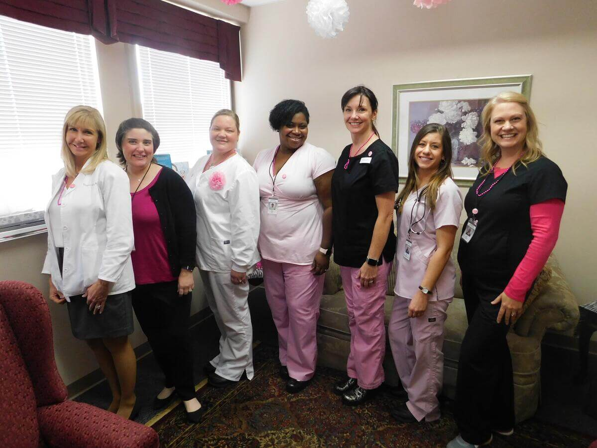 women doctors and nurses wearing pink for breast cancer
