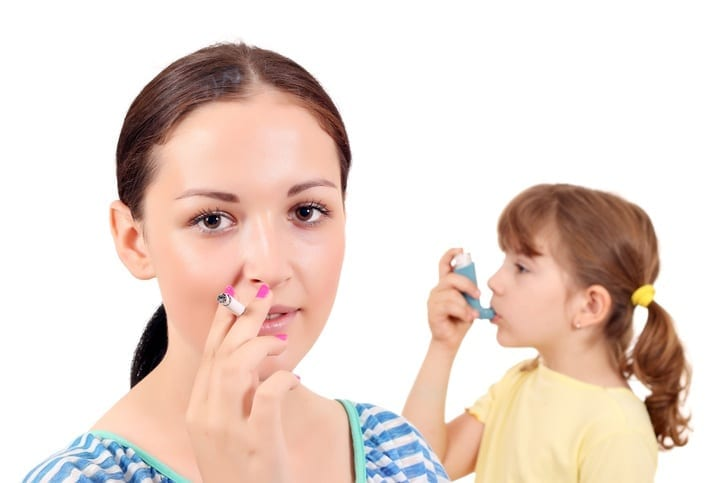 Woman Smoking and Child Using Inhaler