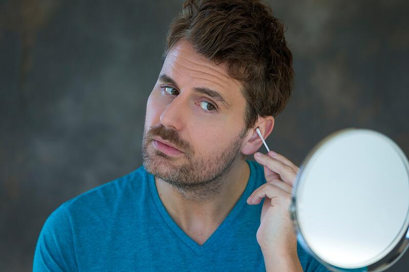 Man Cleaning His Ears With A Q-Tip