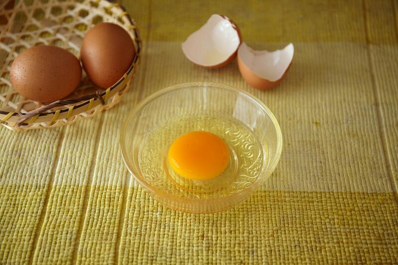 Egg Cracked Open In Bowl