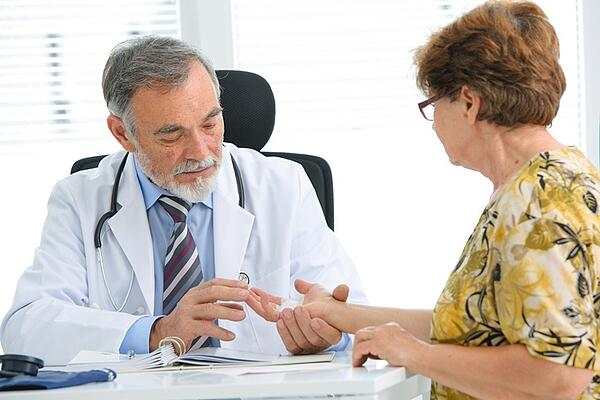 Doctor Examining Woman's Hand