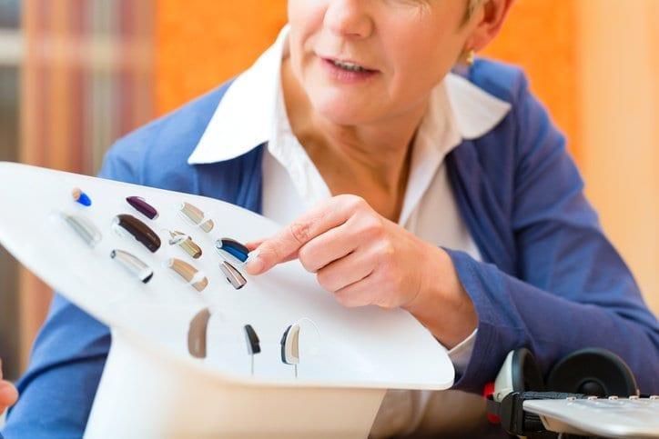 Woman Looking At Hearing Aids