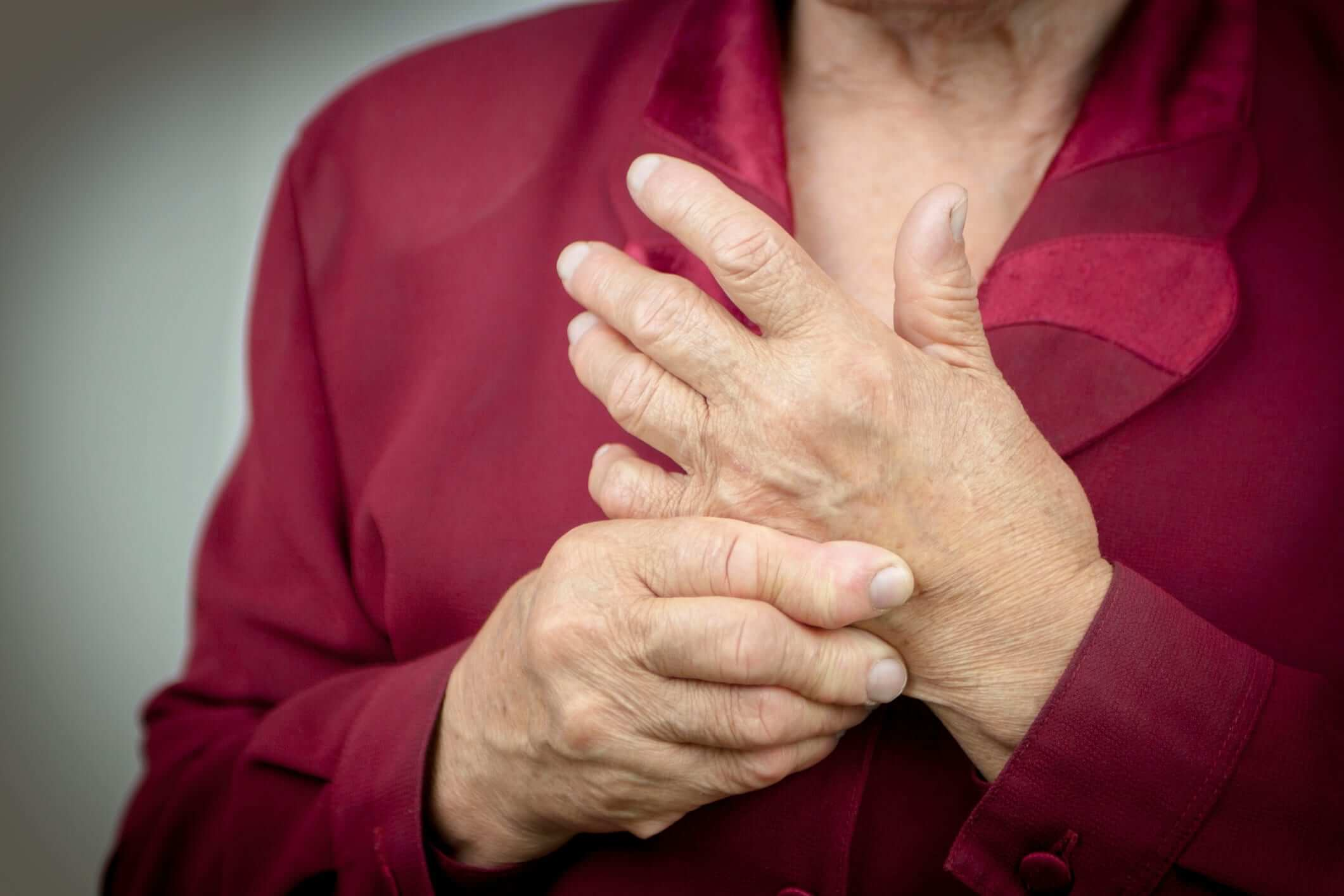 person with arthritis pain in hand