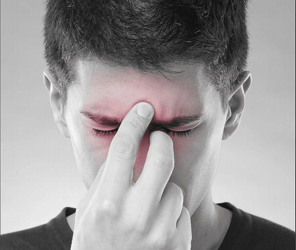Man Holding His Face in Pain