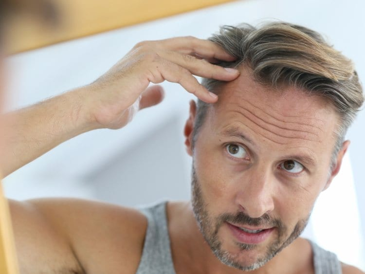 Man With Thinning Hair Visiting Advanced Specialty Care
