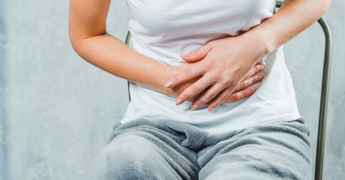 woman with upset stomach from gallstones