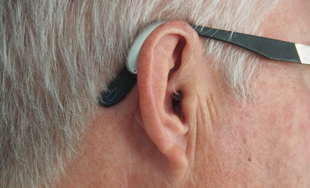 Hearing Aid in Ear. Hearing Aid Feedback. Hearing Aid Whistling.
